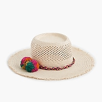 Straw hat with rainbow pom-poms