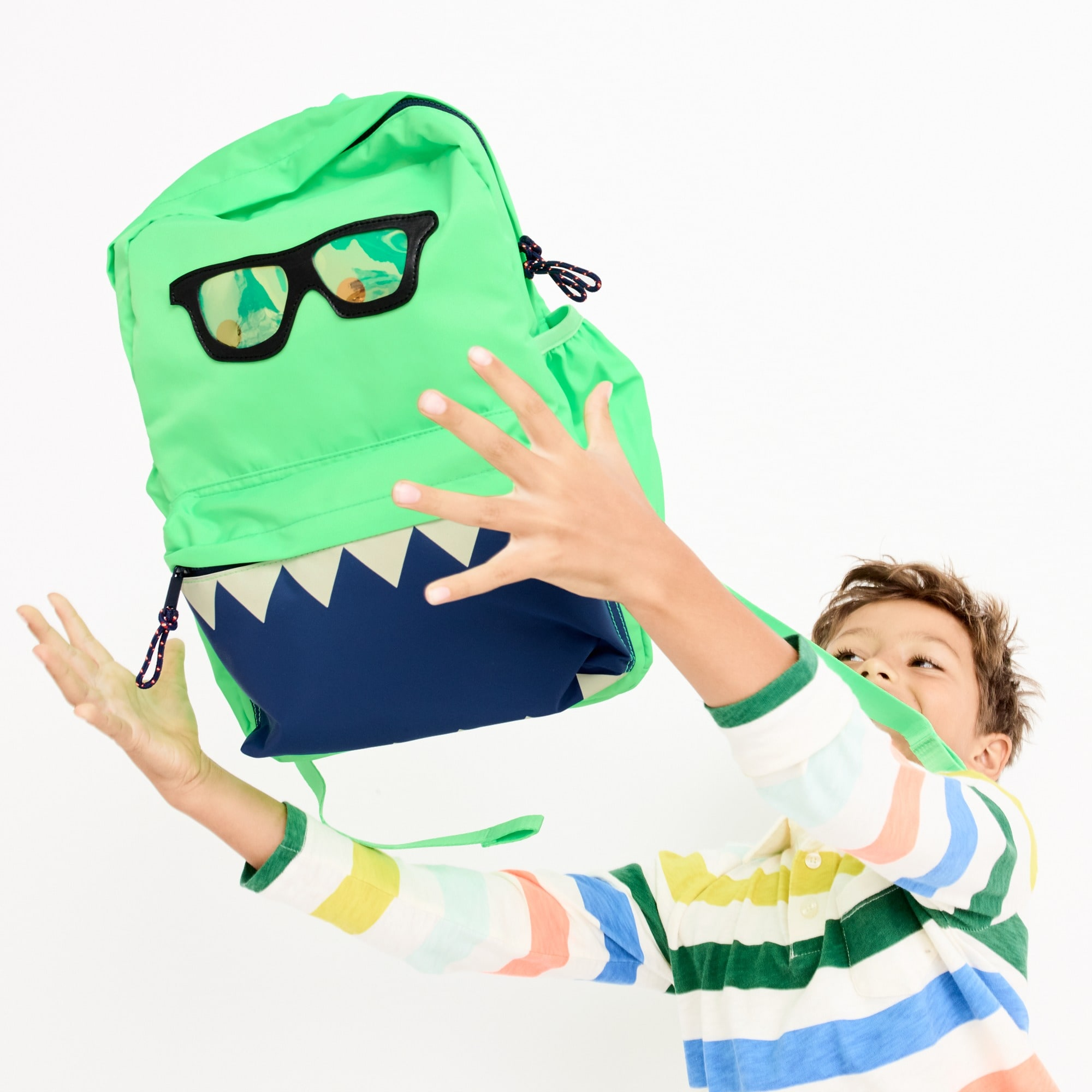 Image 1 for Kids' glow-in-the-dark snaggletooth monster backpack