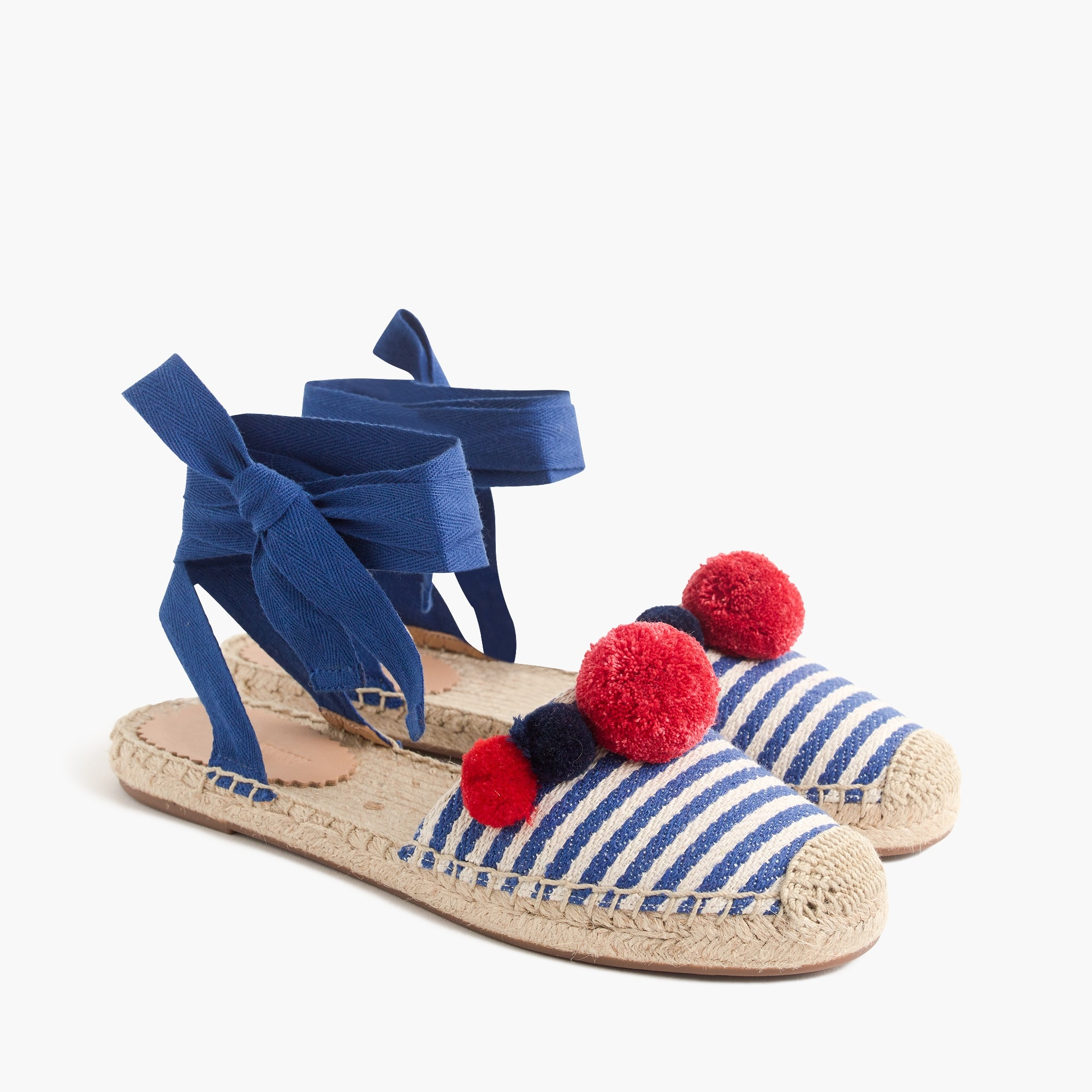 Ankle-wrap espadrilles with pom-poms