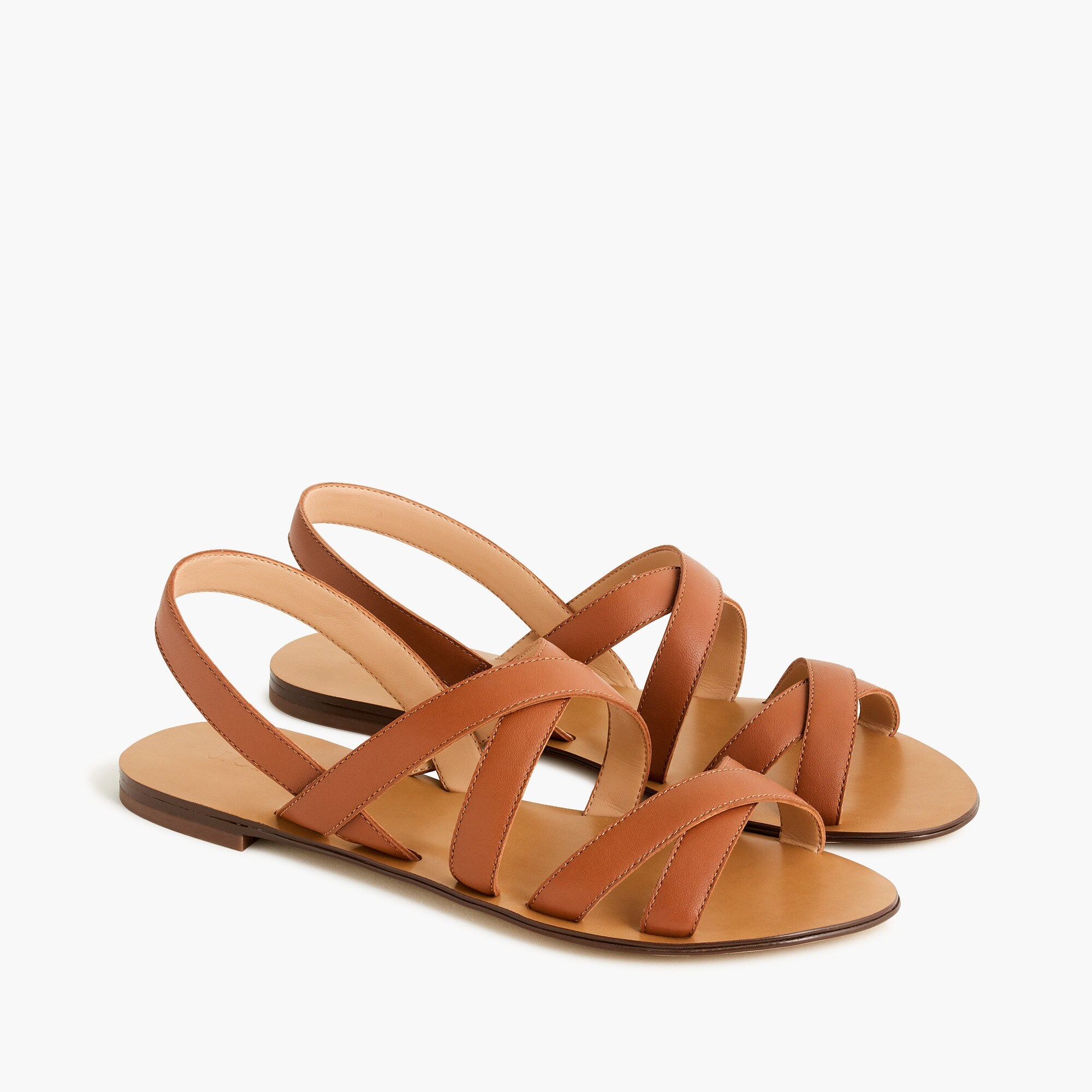 Cross-strap sandals in leather