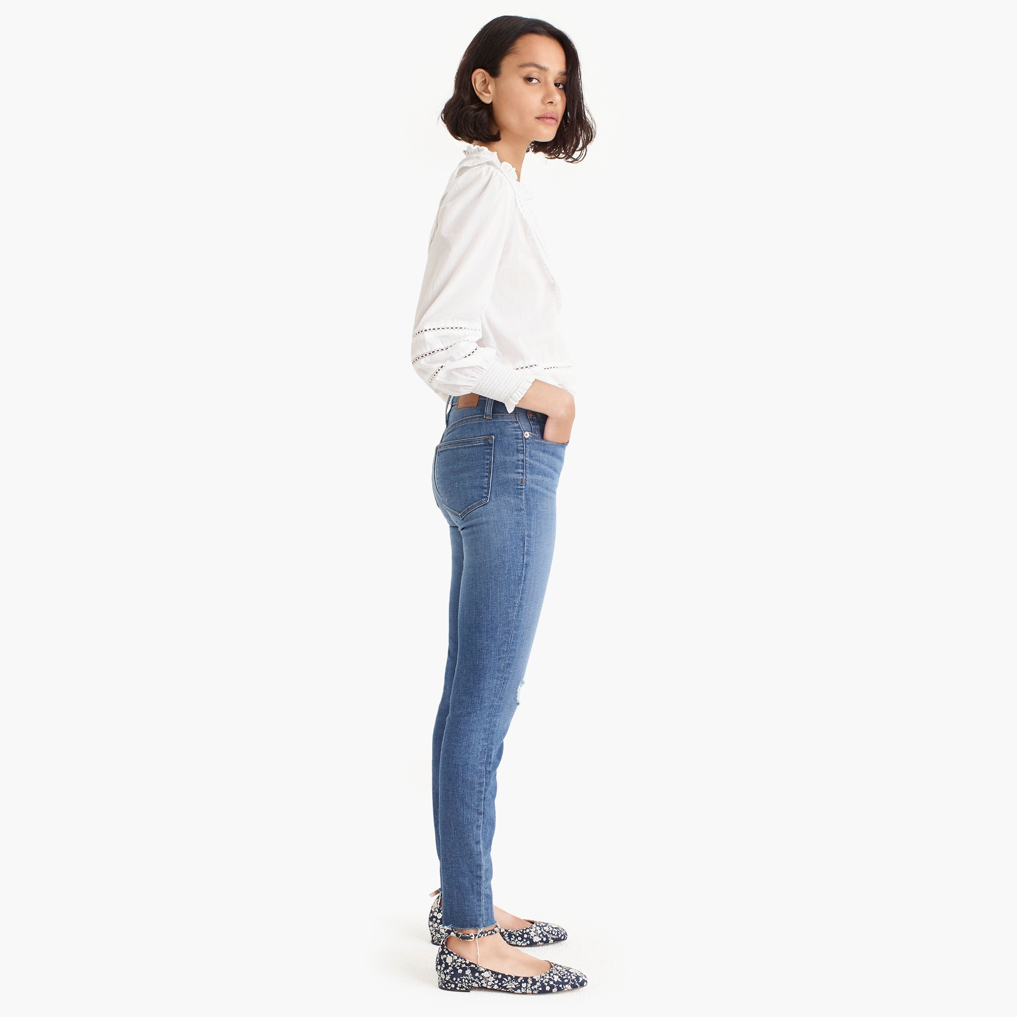 "Tall 9"" high-rise toothpick jean with button fly and cut hems"