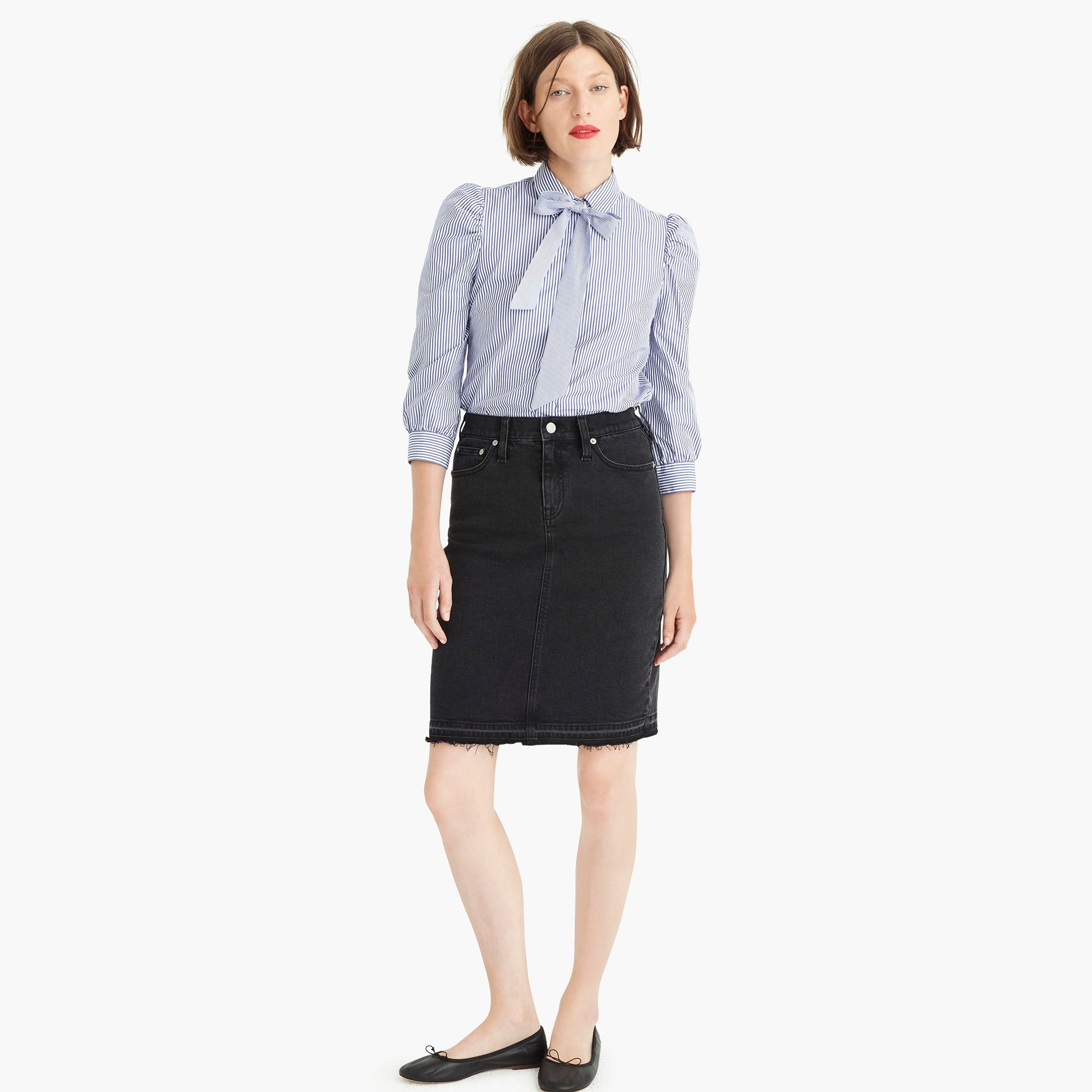 Black denim pencil skirt with let-out hem